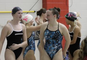 Pioneer and Skyline swimmers mingle during a recent fundraiser.