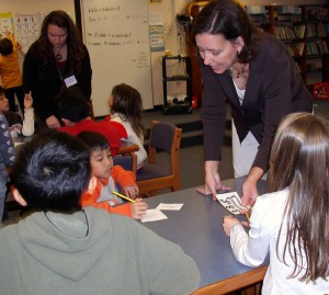 Shelagh Fehrenbach, a U-M apprentice teacher and Media Specialist Ann O'Keefe (foreground) help King Elementary students with their Spanish lessons.