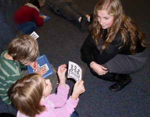Brittany Schwikert, a Spanish major at the University of Michigan, works with students at Ann Arbor Open @ Mack. She is one of 41 apprentice teachers from U-M working with Ann Arbor elementary students this year in a World Language partnership.