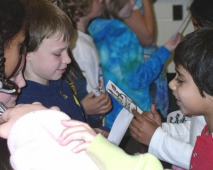 Third- and fourth-graders at Ann Arbor Open @ Mack share with classmates how they learned to speak in Spanish.
