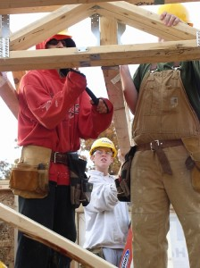 Students install roof trusses on the newest house that is part of the Ann Arbor Student Building Industry Program.