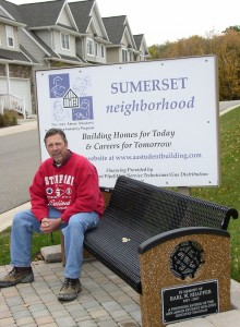 Instructor John Birko at the entrance to the student-built subdivision.