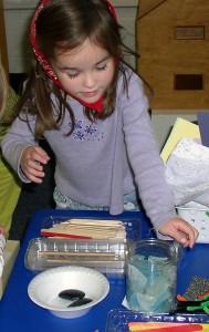 Students work on fairy habitats in their classroom.