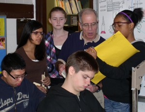Graff works with students at Scarlett.