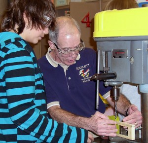Gary Graff works with a student in his classroom at Ann Arbor's Scarlett Middle School.