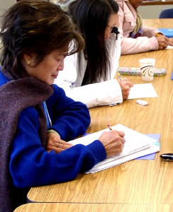 ESL students work on a lesson that teaches them to visualize English words at Stone School in Ann Arbor.