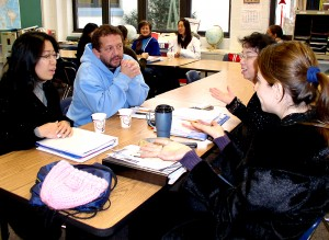 Students in an Ann Arbor Public Schools ESL II class disuss a recent lesson in the English language.