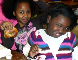 Carpenter Elementary School students enjoy bagels on a recent Friday. Third- and fourth-graders sell them for $1 each to raise money for school programs.