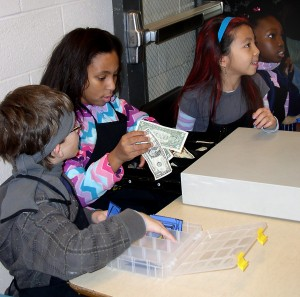 Fourth-graders make change for customers at Carpenter Elementary's Bagel & Bottle Day for Kids. The fundraising and learning based program is every Friday at the school.