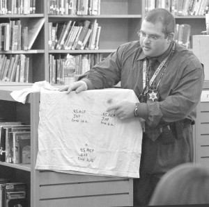 Washtenaw County Sheriff Department Det. Tom Sinks discusses evidence collection with members of Tappan Middle School's new Tappan Law Club. (Photo courtesy, Frank  Weir, Washtenaw County Legal News)