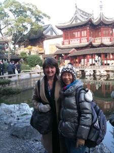 "Kristi Bishop and National Guide ""Wendy"" Hou Liping at the Yu Yuan Garden, Shanghai, China."