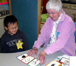 Lois Zimmerman works one-on-one with kindergarten students at Dicken Elementary School.