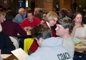 About 100 community members gather on Jan. 7 with school officials at Huron High School to discuss ways to trim the Ann Arbor schools budget. Additional meetings are scheduled for Jan. 12 at Skyline High School, Jan. 14 at Scarlett Middle School and Jan. 19 at Pioneer High School. All meetings start at 6:30 p.m.