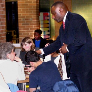 Ann Arbor Deputy Superintendent for Operations Robert Allen answers questions at a table during one of the recent budget meetings.