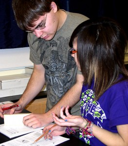 Skyline sophomores work in a physics class, learning about light and prisms.