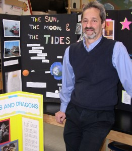 Dan Ezekiel with some past Forsythe Science Fair projects. This year's event is Feb. 14.