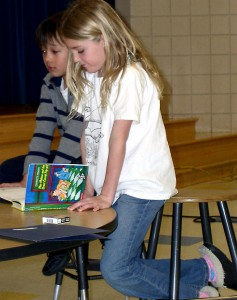 Students at King Elementary help to demonstrate how they learn to read at a recent Literacy Night.
