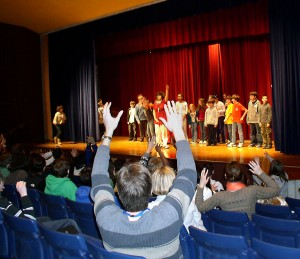 Patrons wave their hands instead of clapping during a recent performance of the Clague Middle School ACT-UP theater troupe.