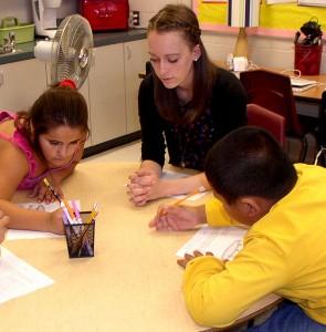 U-M student interns work with Mitchell students.