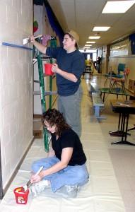 Carpenter painting volunteers