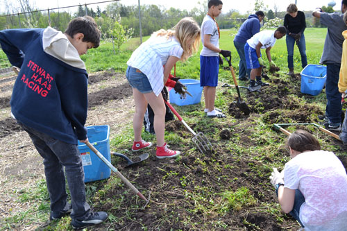Susan Baker's life science class works in the garden April 20.