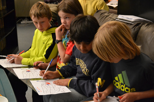 Ann Arbor Open fifth and sixth graders color in an electoral map Tuesday night.