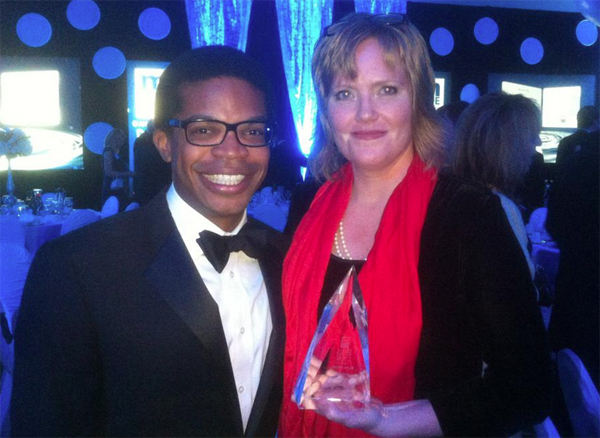 """AAPSEF Board President Omari Rush and PTO Thrift Shop Director of Communications and Community Relations Ann Farnham show off their """"Deal of the Year"""" Award Nov. 2."""