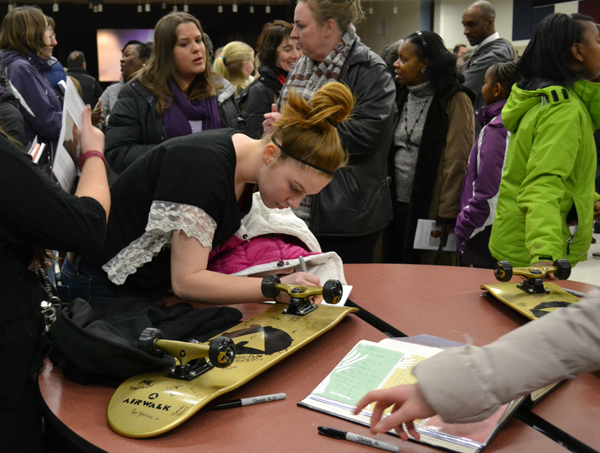Visitors signed golden skateboards in memory of Scott Turner's love of the sport.