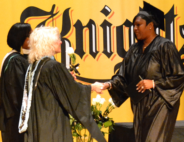 Adult Ed. Director Sharman Speiser congratulates a GED graduate in June 2012.