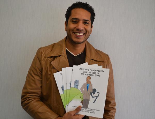 Roberto Clemente teacher Jonathan Royce shows off his debut children's book.