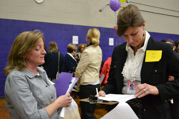 Assistant Superintendent for Elementary Education Dawn Linden looks over a resume.