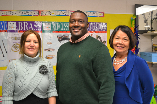 Carpenter art teacher Meredith Giltner, Principal Charles Davis Jr., and music teacher Laura Machida.