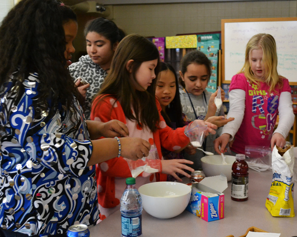 A group of students learns just how much sugar is in soda and health beverages thanks to a Power Monday session at Pattengill Elementary.