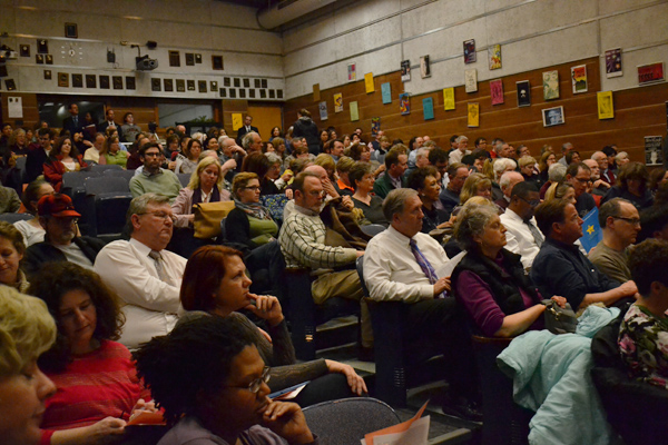 Around 300 community members filled Pioneer's Little Theater for the panel discussion.