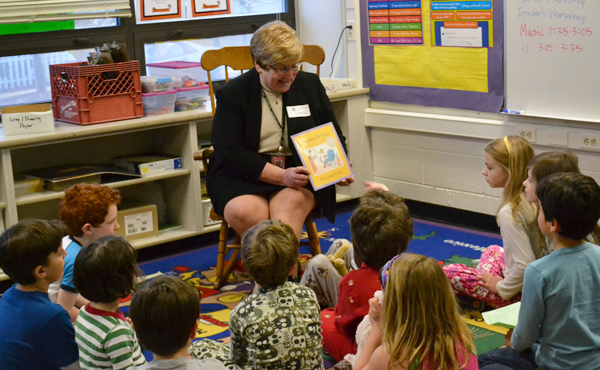 AAPS Superintendent Dr. Patricia Green reads one of her favorite books at Bach Elementary's Family Reading Night March 22.