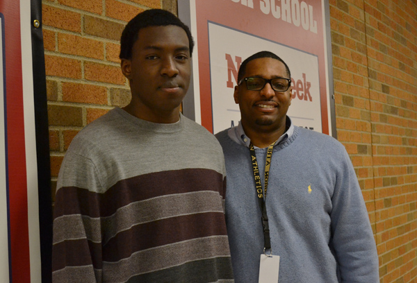 Huron senior Abraham Fasina and counselor Brad Jackson