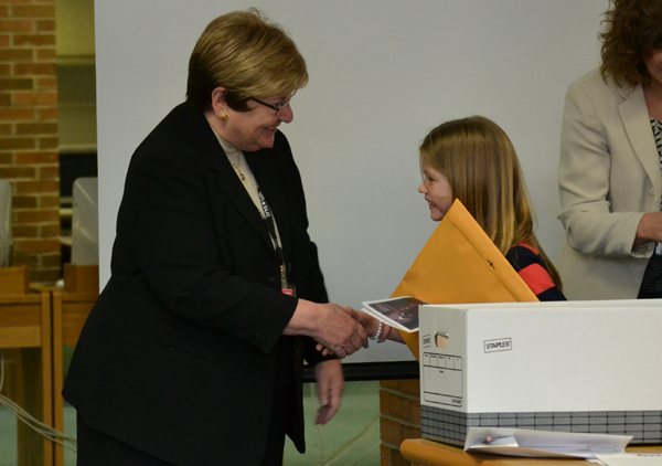 AAPS Superintendent Dr. Patricia Green shakes hands with a student delegate.