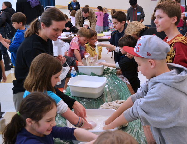 Students play with goop that behaves like a solid sometimes, and a liquid other times.
