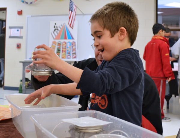 A Hands On Museum exhibit: Flip the jar completely over, and the slip of paper stays on.... and the water doesn't fall out!