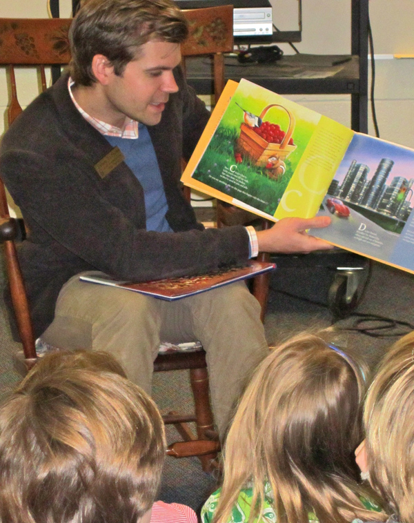 Rep. Adam Zemke reads to a class of first and second graders at Ann Arbor Open March 22.