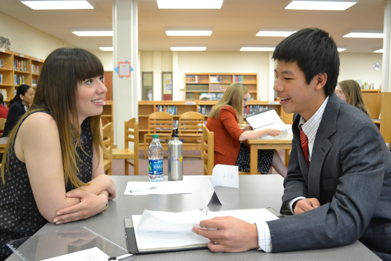 Elyse Guilfoyle from Google interviews a student on Portfolio Day.