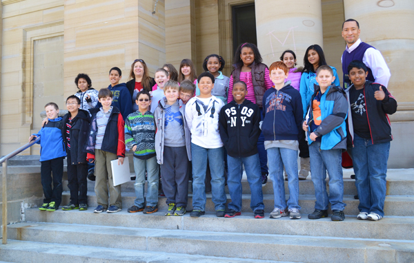 Sean Slay's fifth grade class and Carpenter art teacher Meredith Giltner in front of UMMA