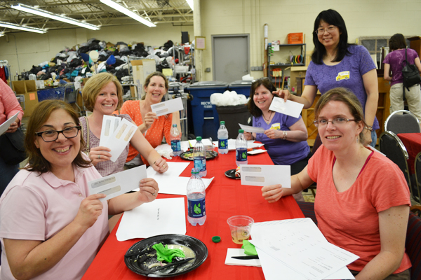PTO Thrift Shop representatives smile May 30 after getting their checks. The reps will deliver the checks to their school PTOs.