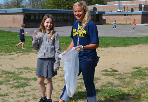 U-M softball player Brandi Virgil helps clean up the school grounds at Abbot.