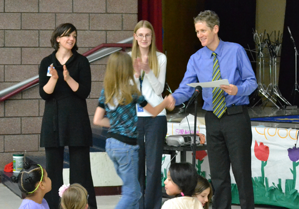 Mitchell Principal Kevin Karr gives out certificates for completing the Digital Dialogues Cultural Exchange on May 14, 2013.