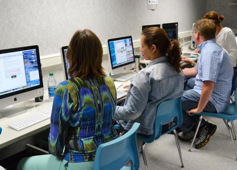 Teachers train on new Macs at Abbot Elementary on Aug. 14, 2013.