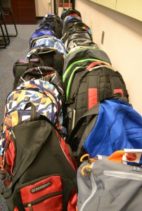 Backpacks stuffed with school supplies await their new owners at Dicken Elementary.