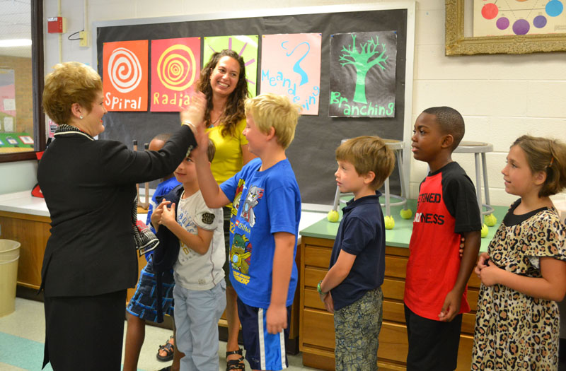 Dr. Swift high fives a student at Thurston Elementary on the first day of school.
