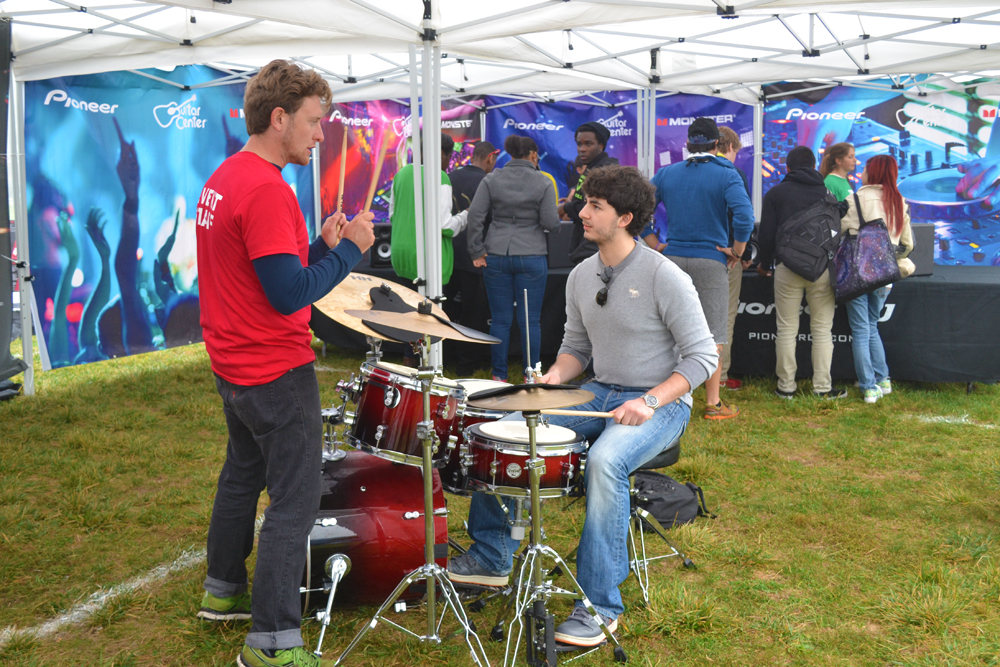 Students tested out instruments at the mini-music festival organized by the High School Nation bus tour on Pioneer's grounds Oct. 2, 2013.