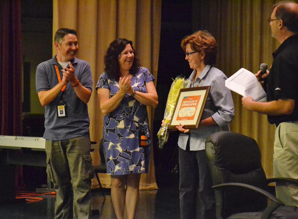 Bach kindergarten teachers David Borgsdorf, Megan Franzen and Patty Zeichman were surprised with $1,000 in office supplies from Office Max.